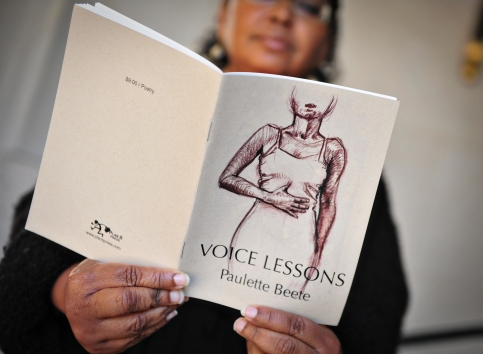 Portrait holding Voice Lessons chapbook